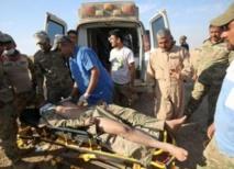 عربات الموت الخشبية تحمل عائلات ضحايا القصف على الموصل