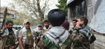 مقاتلون من حركة النجباء العراقية الشيعية المدعومة من إيران وسط دمشق