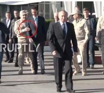 بوتن في قاعدة حميميم وخلفه وليس بجانبه الاسد