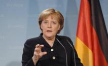ميركل تشيد بالتوصل إلى اتفاق مع اليونان حول إعادة اللاجئين