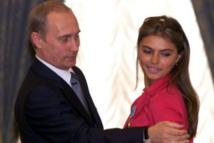 لاعبة الجمباز السابقة كاباييفا مع بوتن - انترنت