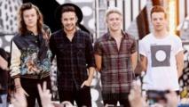 """فريق """"وان دايركشن"""" يتصدر جدول مبيعات الأغاني في بريطانيا"""