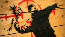 عرض رسومات لفنان الجداريات البريطاني بانكسي في روما