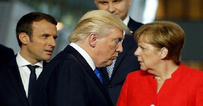 المفوض الأوروبي للاقتصاد يطالب ميركل بالتصدي لترامب بقمة العشرين